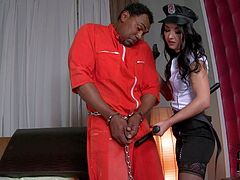 Handcuffed prisoner gets his big black dick sucked by Angelik Duval