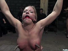 They tie her up and a bunch of people toy with her, humiliating her and abusing her, not to mention fucking fucking her, check it out!