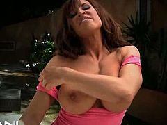 Watch the busty and perverse brunette milf Devon Michaels flaunting her hot body in this sexy video. Then she's ready to finger and dildo her hot pussy into heaven while teasing you with her big round tits.