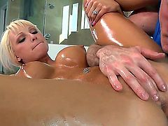 Tempting tanned blonde pornstar Rikki Six with big fake hooters and hot ass gets her body oiled during arousing massage by dirty dude and takes on his cock with great lust.