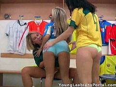 A couple of chicks wearing football shirts get freaky with each other in the store and start sucking on each others' pussies!