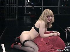 Kinky milf with glasses uses sex toys