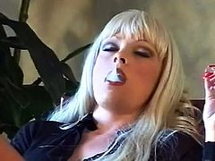 Dirty blonde in sexy pantyhose rubs her wet vag while smoking and moaning