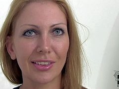 Attractive tempting and seductive cougar with slim sexy body in black undies and outfit teases and reveals big jaw dropping hooters at the interview filmed in close up