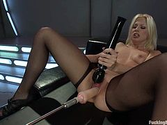Stunning blonde girl in pantyhose lies on a couch and gets her ass stuffed with big dildo. Later on she also gets toyed in her pink pussy by the fucking machine.