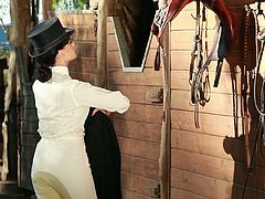 Hot brunette Rivi Madison is having a photosession in the yard. She takes her white trousers and jockey cap off and demonstrates her nice body.