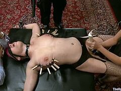 Juliette March and some other women get tied up and spanked by Maestro Stefanos and his guests at a banquet. The guys torment the girls and poke their dicks into their mouths.