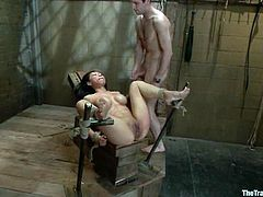 Asian girl in the stocks gets clothespinned and tied up. She also sucks big dick and gets her pussy drilled.