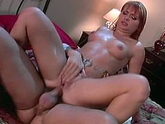 Dazzling brunette with short hair is riding cock