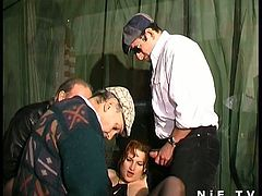 After getting picked up, this nasty French redhead slut gets taken to a strange meeting. There you can see her blowing three dudes with her perversely skilled mouth.