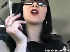 See the hot brunette babe Mina taking her time to smoke in a very sexy way in this spectacularly sexy vid.