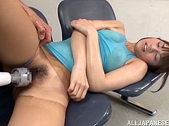 This horny Japanese babe needs to keep herself in shape in order to be desirable. Then her fitness coach oils her ass up and starts playing with her hairy pussy!