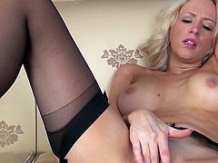 Horny blonde babe Sam does a fine job in this solo scene of not only entertaining herself with fingers,but also us, the audience, with her out of this world feminine wiles.Enjoy!