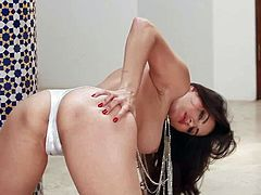 Sunny Leone is a beautiful dark haired porn diva with juicy boobs. She shows her assets with smile on her face and pulls off her white panties in a playful manner. Watch Sunny Leone strip and rub her pussy.