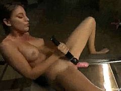 Brunette babe with hot body pleases her clit with a vibrator while the fucking machine drills her pussy deep.