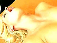 Precious blonde babe Erica Fontes with cool tattoos on her belly and pierced navel is having great pleasure of masturbation with Hitachi vibrator.