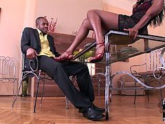 Curvy dark skinned bitch seduces the guy rubbing his pants with her feet. The guy with foot fetish licks her tender tootsies. Later she reveals hard flesh out of his pants sucking it deepthroat. She gives awesome sloppy blowjob.