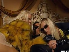 Two beautiful blondes Ellen Saint and Stacy Silver are trying hard to please this dude. They suck and rub his schlong devotedly and then take it into their vags and brown eyes.