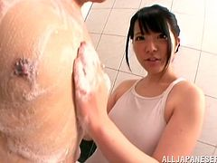 Cute Japanese bitch Ai Uehara wearing a swimsuit is having fun with some guy in a bathroom. She lets him rub her wet snatch and then drives him crazy with her cock-sucking abilities.