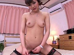 Sexy Japanese girl in fishnet stockings comes up to a guy and takes his dick in her hairy vagina. She moans and groans with great pleasure.