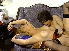 Horny babes are sharing large dick in naughty vintage porn threesome session