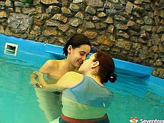 Sizzling hot lesbians are having an unforgettable time together. They swim half-naked and then they begin to tease each other.