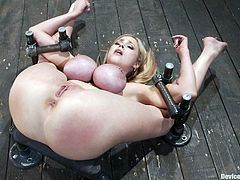 Nothing like seeing a big breasted beauty like Katie Kox getting her big tits tortured and her pussy toyed as she's bounded in a very exposed position.