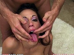 Watch this slutty brunette swallowing a big load of cum as her eyes are teary after deep throating this guy's large cock and a dildo.