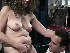 Sandra Bernhart makes Dino Bravo put his face between her tits and deep inside her cunt. He eats her out and sucks on her nipples hard because she makes him do it. That is the only way he would fuck such an ugly bitch. She sucks him off, too.
