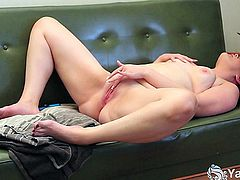 Awesome brunette stunner Lexus masturbating her shaved pussy with a blue dildo on the couch