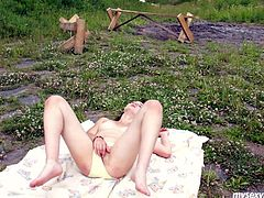 Divine Russian chic demonstrates her cuddly tits before she lies on the bench fully naked to stroke her shaved punani with hand in close up sex scene by My Sexy Kittens.