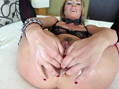 Pretty smoking blonde Sheena Shaw with natural boobs and arousing heavy make up in stockings only enjoys fisting her round firm ass while teasing Jonni Darkko in point of view