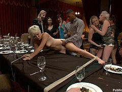 This short-haired blonde whore is tied up and abused on some dinner table while people watch the kinky action as it goes down!
