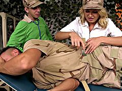 Horn made blond MILF hooks up two sex hungry soldiers for insane MMF sex orgy. She is forced to give blowjob to one of them while another soldier polishes her dripping wet vagina with his skillful tongue.
