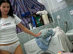 Bonerific girl with next door girl look appears on screen wearing white T-shirt and panties. She plays with her wet coochie sitting on a washing machine. She also shows her cameltoe.