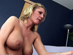 This petite and sassy blond milf Zoe Holiday gets naked and starts sucking a huge cock! She is so fucking in love with it, as it is tasty and damn big!