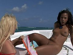It's a hot lesbian sex video with anal toying and more going on on a boat! Keisha Kane and Leigh Logan are the ladies in action.