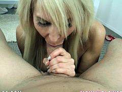 Slutty blonde mom Erica Lauren gets on her knees in front of some guy and begins to suck his prick. She does it well and soon manages to milk it dry into her mouth.