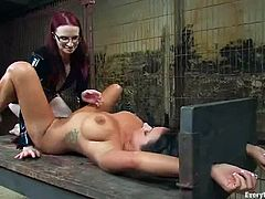 This is a crazy lesbian bondage and latex BDSM action. One of them is tied up and the other one is allowed to do whatever she wants with her.