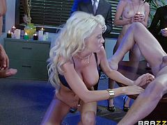 Attractive blonde secretary Courtney Taylor with big round balloons and nice oral skills in high heels gets her holes drilled at the same time by Tommy Gunn and Will Powers
