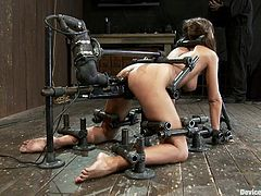 Gorgeous babe getting fucked by machine in bondage video