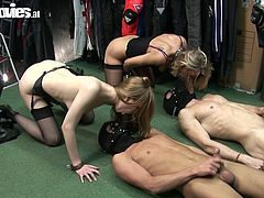 Giulietta Canale and Marga X dominate their slaves as they lay on the ground. They sit on their faces and make the male slaves jerk off. With strap on tied to their mouths the ladies use the men as sybians.