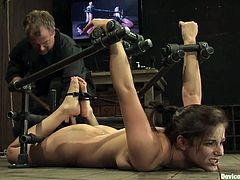 The look on this girl's face as she's suffering bondage is great. Also the fact that there's a dude putting a dildo in her vagina must have something to do with that face.