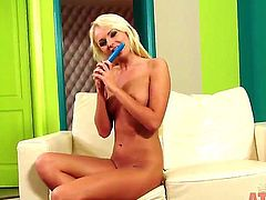 Blonde Ivana Sugar does striptease before she sticks her fingers in her muff