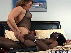 This dirty fucking skank rides rides this dude's big black cock and then the fucker shoots the jizz in her fucking mouth.