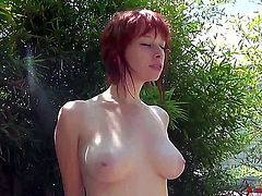Adorable young slender redhead babe Zoey Nixon with big natural boobs and soft milky skin gets naked and enjoys posing for photographer in backyard on a sunny summer day.