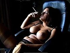 Sexy babe likes posing her big boobs and lingerie while smoking a cigarette