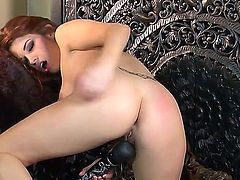 Lovely red haired chick Sabrina Maree uses a vibrator to satisfy her lust and need for sex