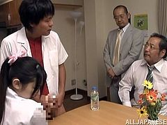 Japanese girl in school uniform sits on a chair in a dining room. She has to touch dude's dick and it is seems that she does not like it. After that she gets blindfolded with a sleeping mask. Then she sucks a cock and gets her face covered with cum.