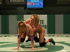 Krissy Lynn and Lea Lexis fight in a battle. Krissy Lynn loses a battle, so she gets toyed with a strap-on from behind.